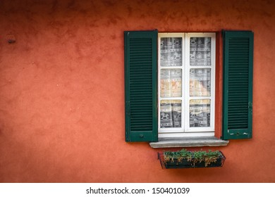 red wall, green blinds and white window