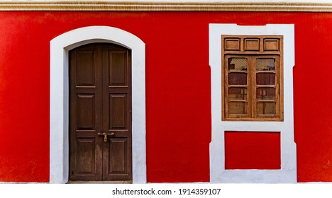 Red wall of house in fontainhas Panjim Goa.