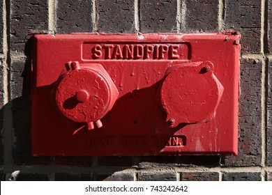 Red wall mounted standpipe. New York. USA.