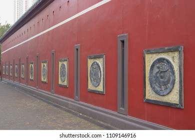 Red wall with sign of Che Kung temple.