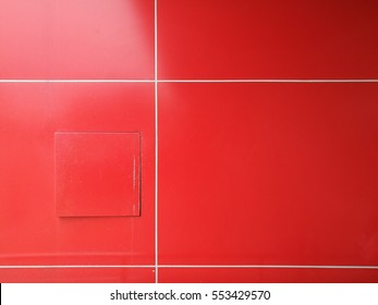 red wall with white cross line and door of service shaft