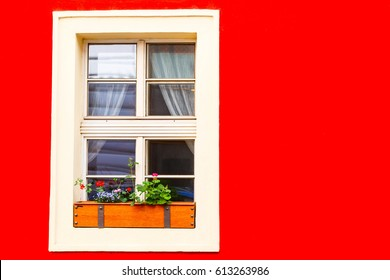 Red wall and white window on old street, Prague, Czech Republic