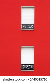 Red wall and windows with roller shutter