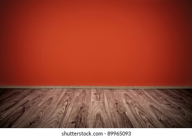 red wall and wooden floor interior design