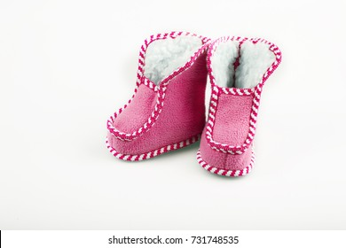 red warm baby shoes on a white isolated background