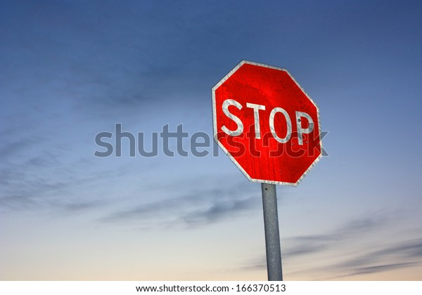 """Red warning sign """"STOP"""""""