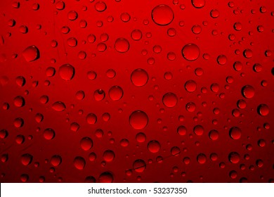red water drops on glass