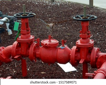 Red water main pipes in lava rocks