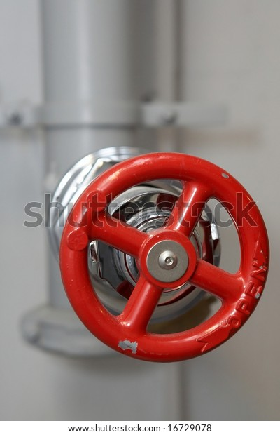Red water pipe plumbing valve in factory