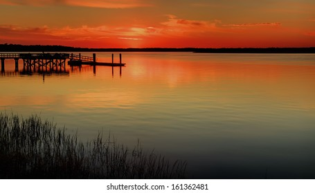 """""""Red Water"""" Sunset on the Colleton River tidal estuary in Beaufort County SC."""