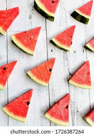 Red watermelon placed on a white table