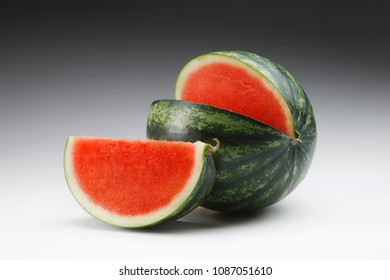 Red watermelon and wedge without seeds on gradient background