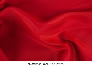 red waves of precious fabric