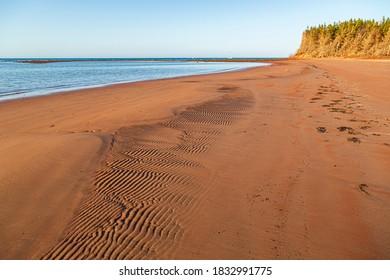 Red, wavey, sandy beach in Prince Edward Island