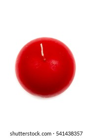 Red wax candles isolated on a white background. Red candle in a shape of sphere/ ball. Christmas, New Year, winter, seasonal decoration. Interior accessory. Closeup.