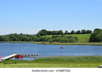 Red Whaley Boat at Jetty, Devenish Island, Lower Lough Erne, County Fermanagh, Northern Ireland