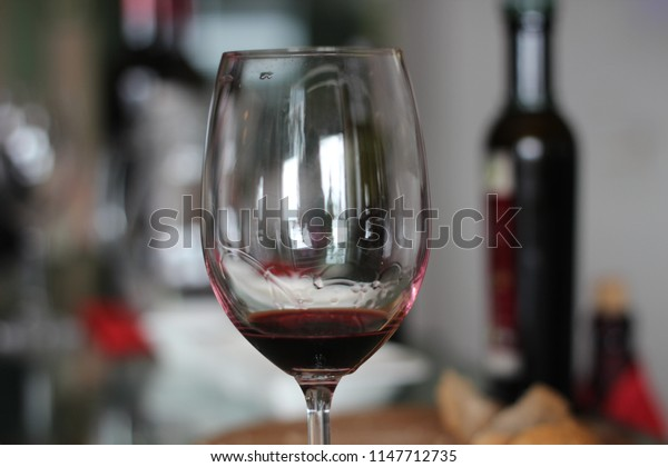 red whine glass bottle stone