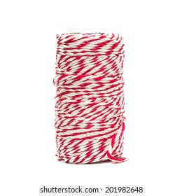 Red and white baker's twine spool isolated on white background