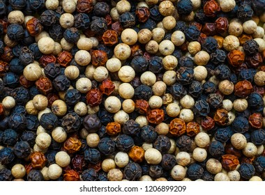 Red, white, black Cambodian kampot pepper mix as background