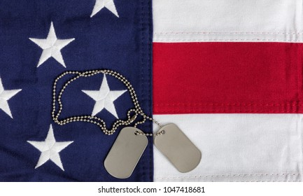 Red, white and blue American flag with ID tags for Memorial Day or Veteran Day backgrounds