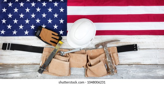 Red, white and blue American flag with industrial tools for Labor Day background