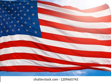 Red White and Blue American Flag Waving in the Wind