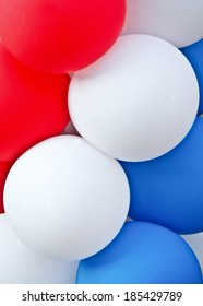 Red, white and blue balloons vertical