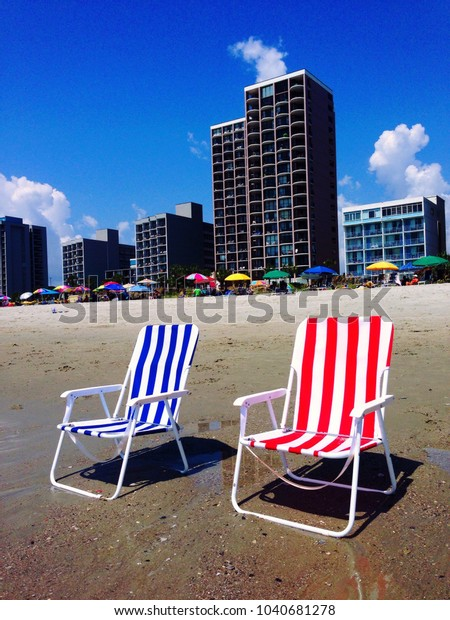 Prime Red White Blue Beach Chairs On Stock Photo Edit Now 1040681278 Short Links Chair Design For Home Short Linksinfo