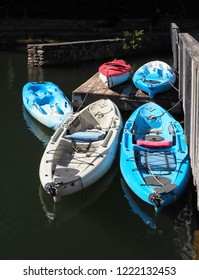 Red White and Blue Kayaks on or Chained to the Dock Ready for Adventure