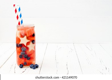 Red, White and Blue lemonade or sangria. Patriotic drink cocktail with watermelon, blueberry and apple for 4th of July party. Fruit infused water