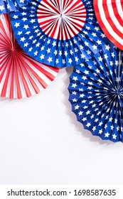 Red, white, and blue paper fans for July 4th celebration.