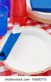 Red, white and blue picnic table setting is ready to celebrate  a festive summer holiday meal.
