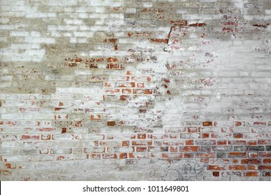 Red White Brick Wall Grunge Background . Old Grungy Brick Wall With White Uneven Stucco. Horizontal Brickwork Rustic Texture. Vintage Wall With Peeled White Plaster. Retro Grunge Wall Backdrop
