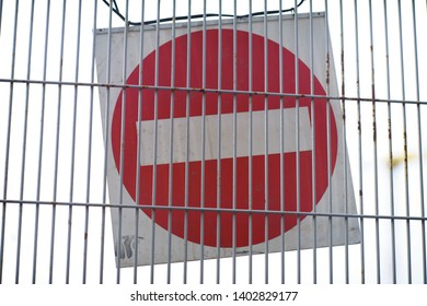 Red and White British No Entry Road Sign with Steel Fence, Red Stop Road Sign, Traffic Sign Prohibiting, Fence Grilles Rust Texture Background, Warning Sign at Fence Wall, Prohibition Concept