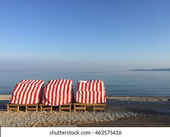 Red and White Cabanas by the Lake.