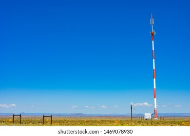 Red and White Cell Phone Tower in the countryside of South Africa