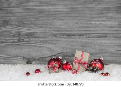 Red white checked christmas presents on old grey wooden background for a gift certificate.