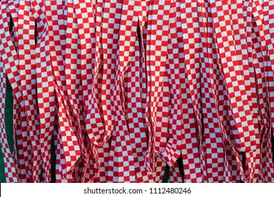 Red and white checkered ribbon, band