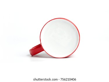 Red and white coffee cup mockup lying on white background