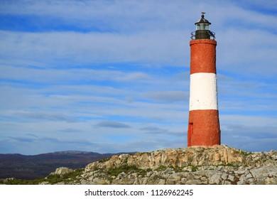 Red and white colored lighthouse on a small island in the Beagle channel, Ushuaia, Tierra del Fuego, Argentina