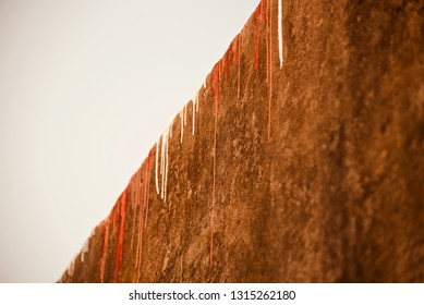 Red and white colours painted on a concrete wall