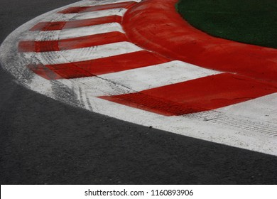 Red white curb with tyre skid marksclose up at race track chicane