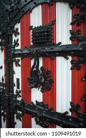 Red and white decorations on the doors and window shutters of De Haar Castle. The colors are derived from the family coat-of-arms of the Van Zuylen family, that used to own the castle.