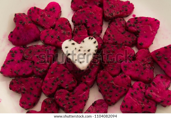 Red and white dragon fruit heart shaped