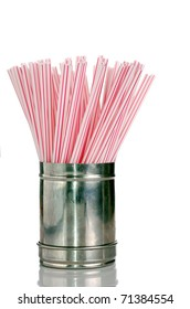 Red and White Drinking Straws in a Straw Stainless Steel Dispenser