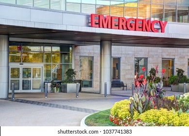 Red and white emergency room sign outdoors at hospital