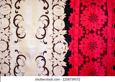 Red and white fabrics finely-worked embroidered.