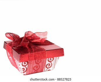 Red and white gift box with red lace ribbon on white background. Copy space.