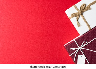 Red and white gift box, ribbon bundle on red background