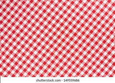 Red and white gingham tablecloth diagonal texture background